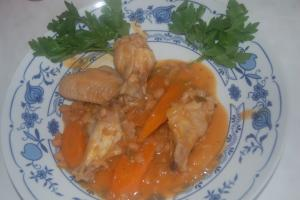 cpicy chicken wings garnished with paarsley